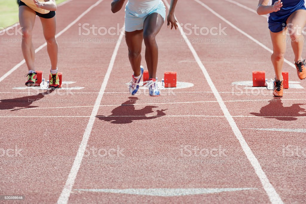 Runners on track stock photo