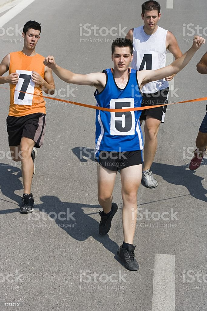 Runners reaching finish line royalty-free stock photo