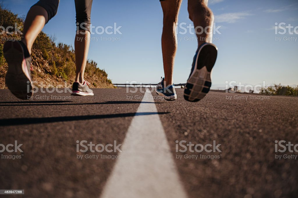 Runners running on the road stock photo