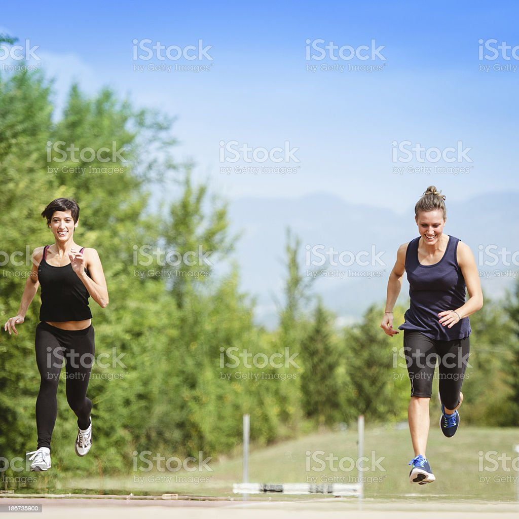 runners running on the track royalty-free stock photo