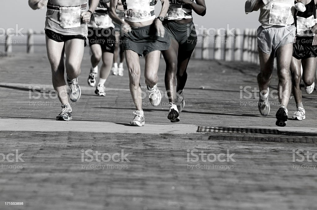 Runners spread accrosss a road stock photo
