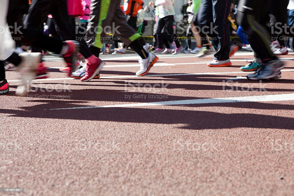 Runners to run through at full power stock photo