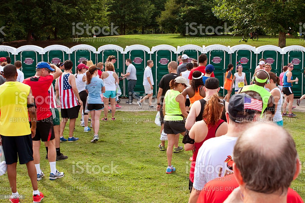 10K Runners Wait In Line To Use Portable Toilets stock photo