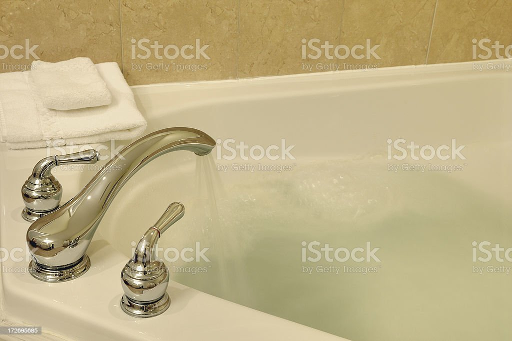 Running a bath royalty-free stock photo
