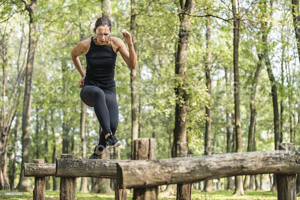 Running across wooden hurdles stock photo