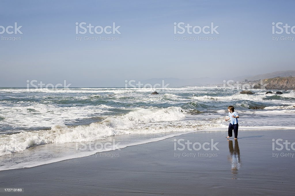 Running Along Edge of water royalty-free stock photo