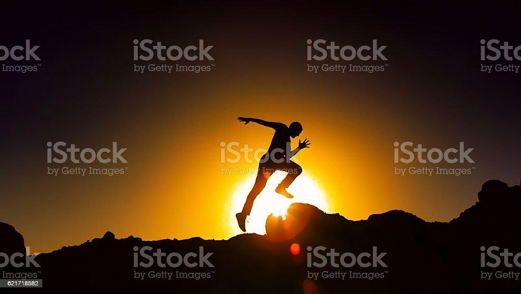 Running And Climbing At Sunset stock photo