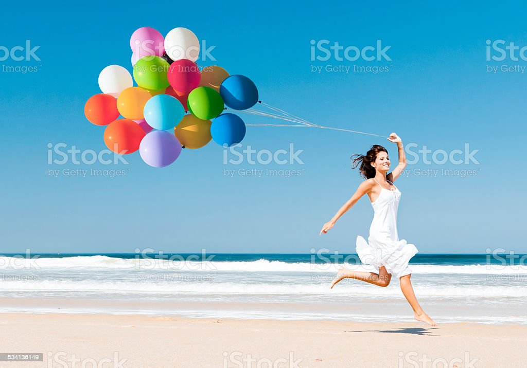 Running and Jumping with ballons stock photo