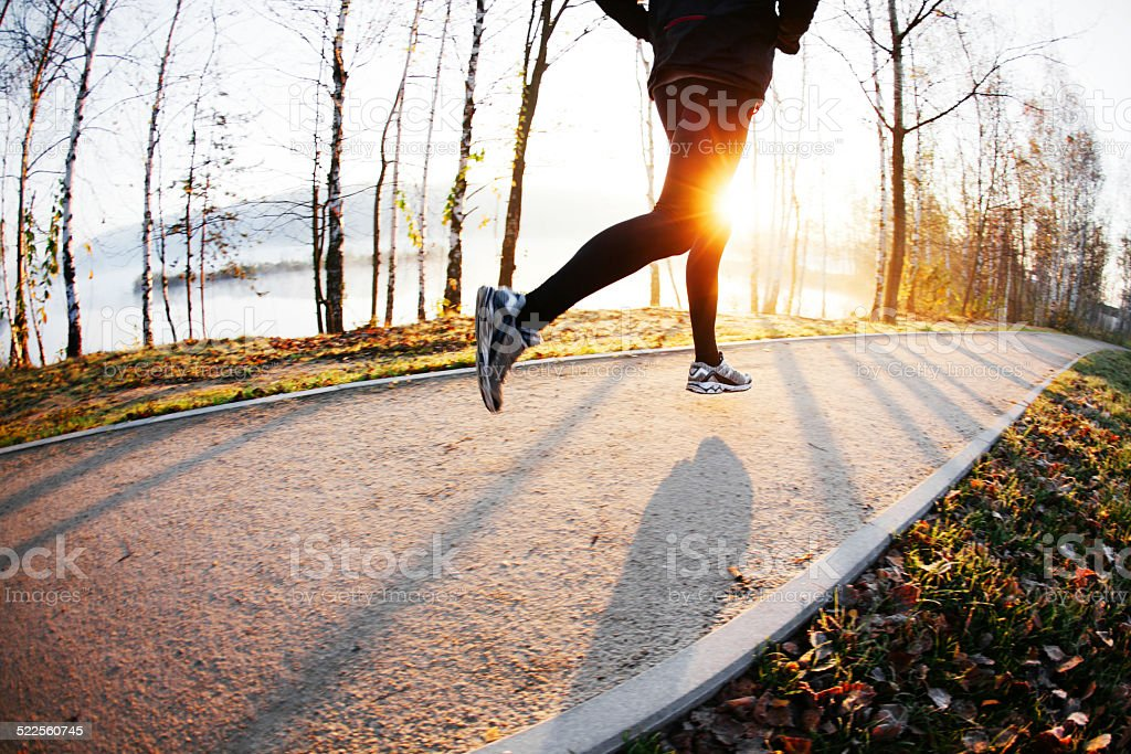 Running at autumn morning stock photo