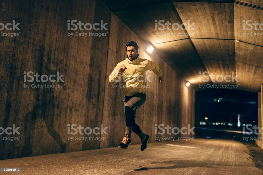 Running at night stock photo