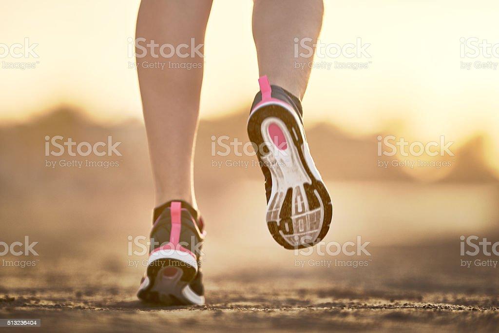 running at sunrise stock photo
