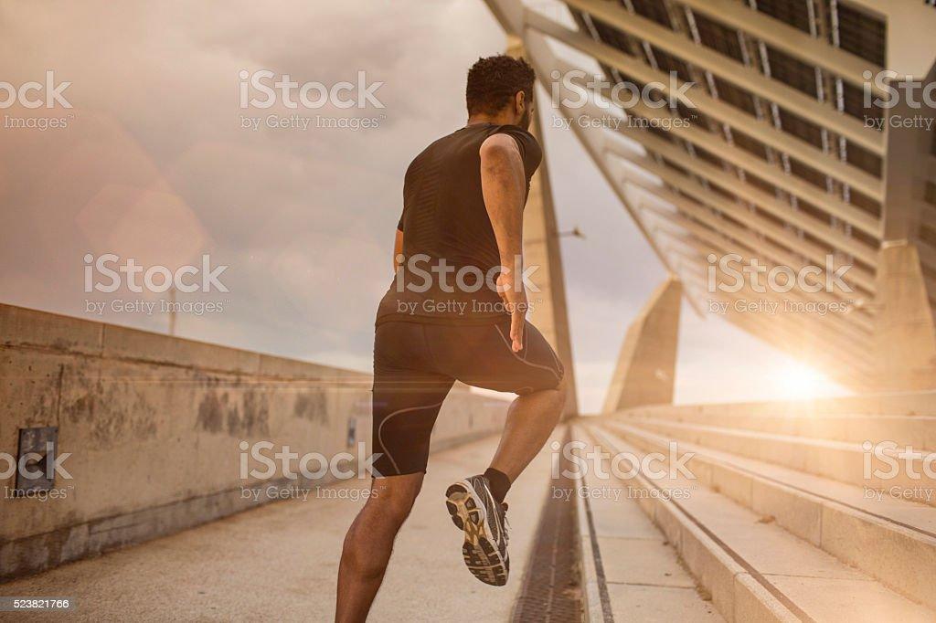 Running at sunset stock photo