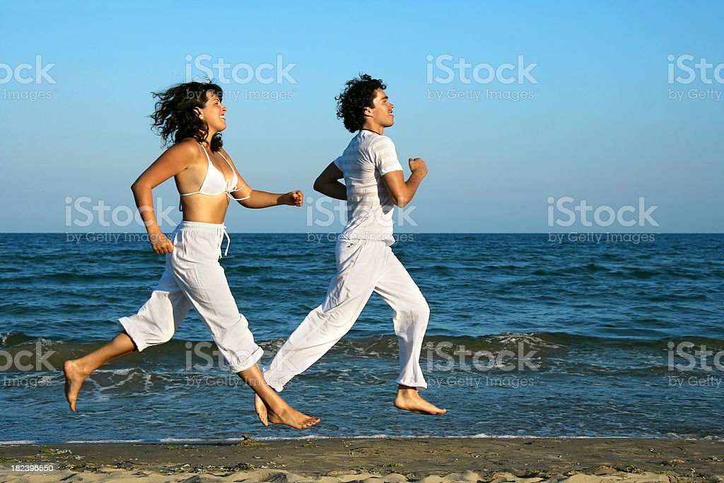 Running at the beach royalty-free stock photo