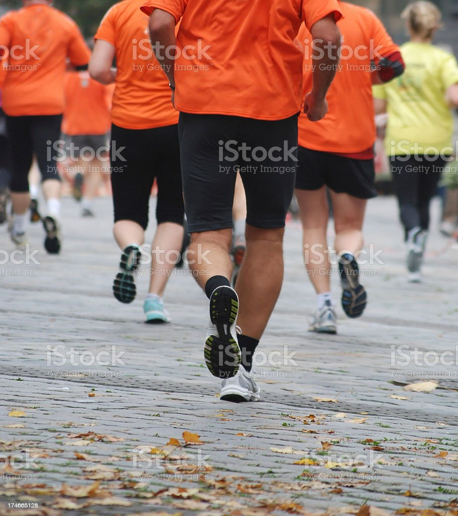 running competition with orange shirts copyspace stock photo