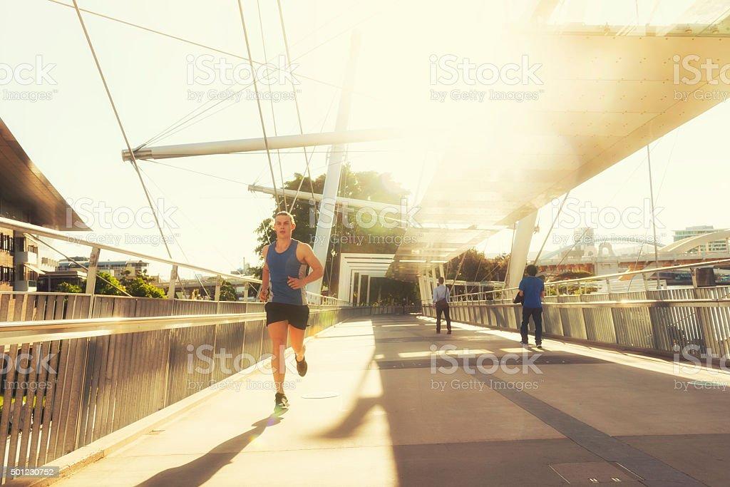 Running during sunset in Brisbane stock photo