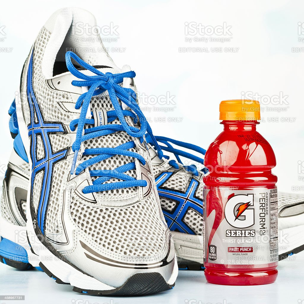 Running Essentials: Sports Shoes and Gatorade stock photo