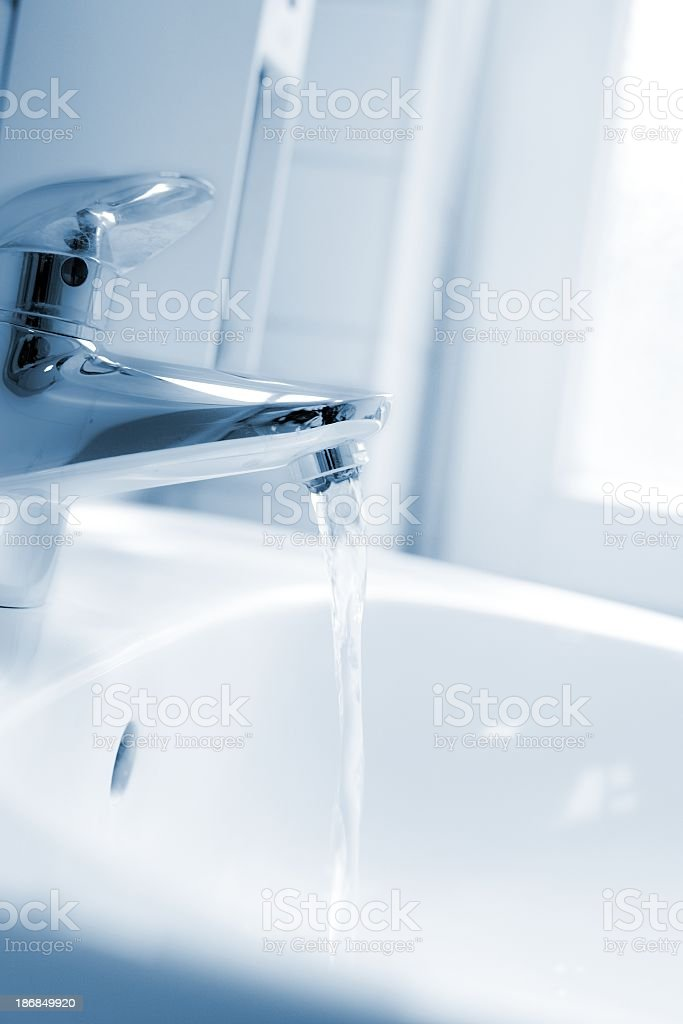 Running faucet - in bath soft focused stock photo