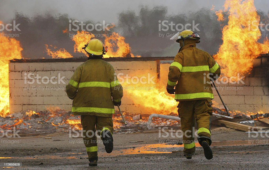 Running Firemen stock photo