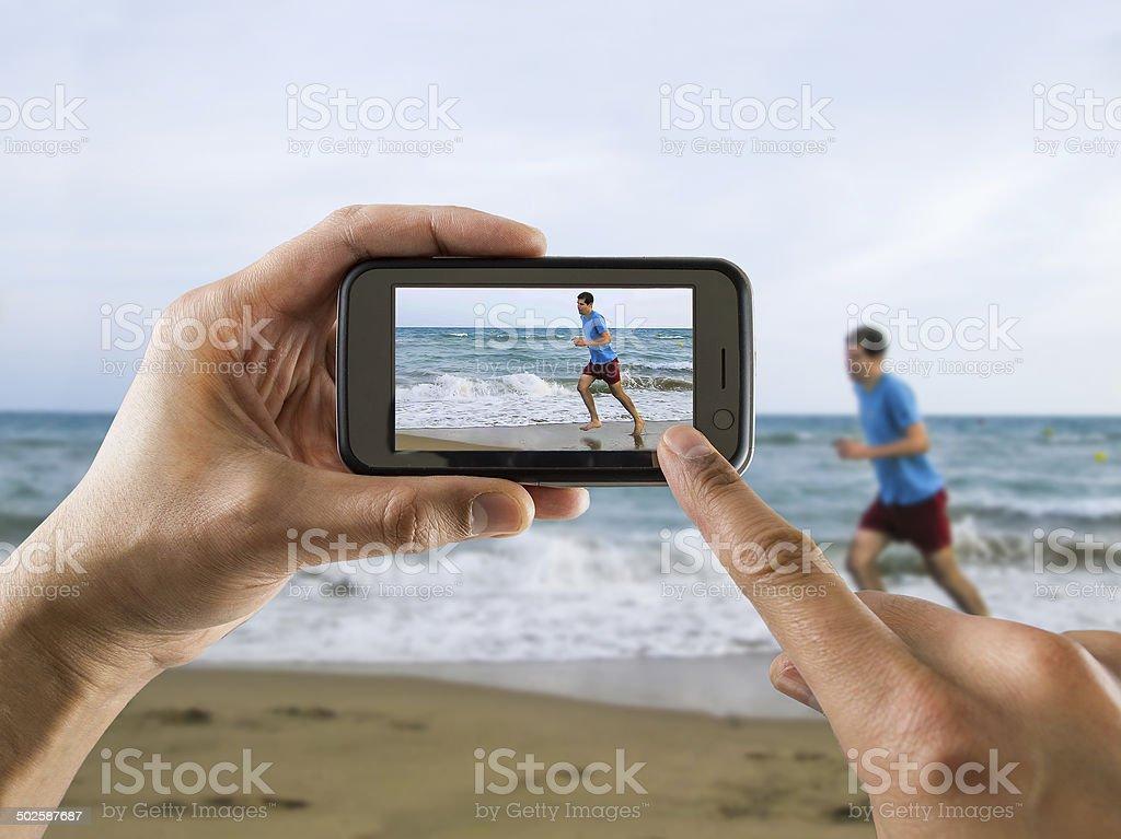 running for joy on the beach stock photo