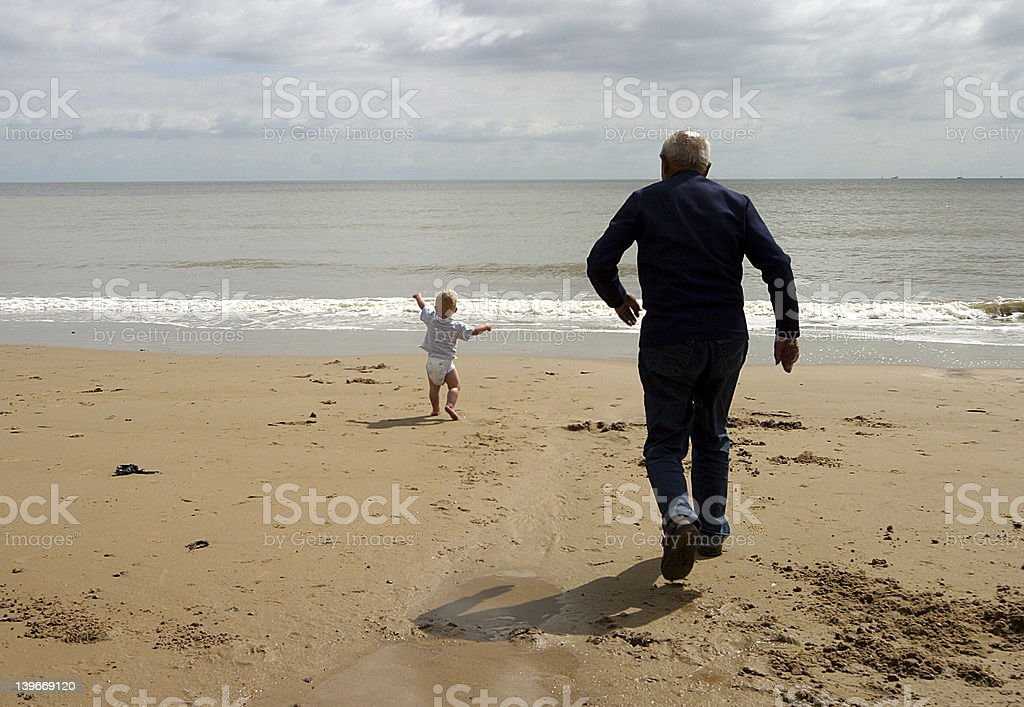 Running for the sea royalty-free stock photo
