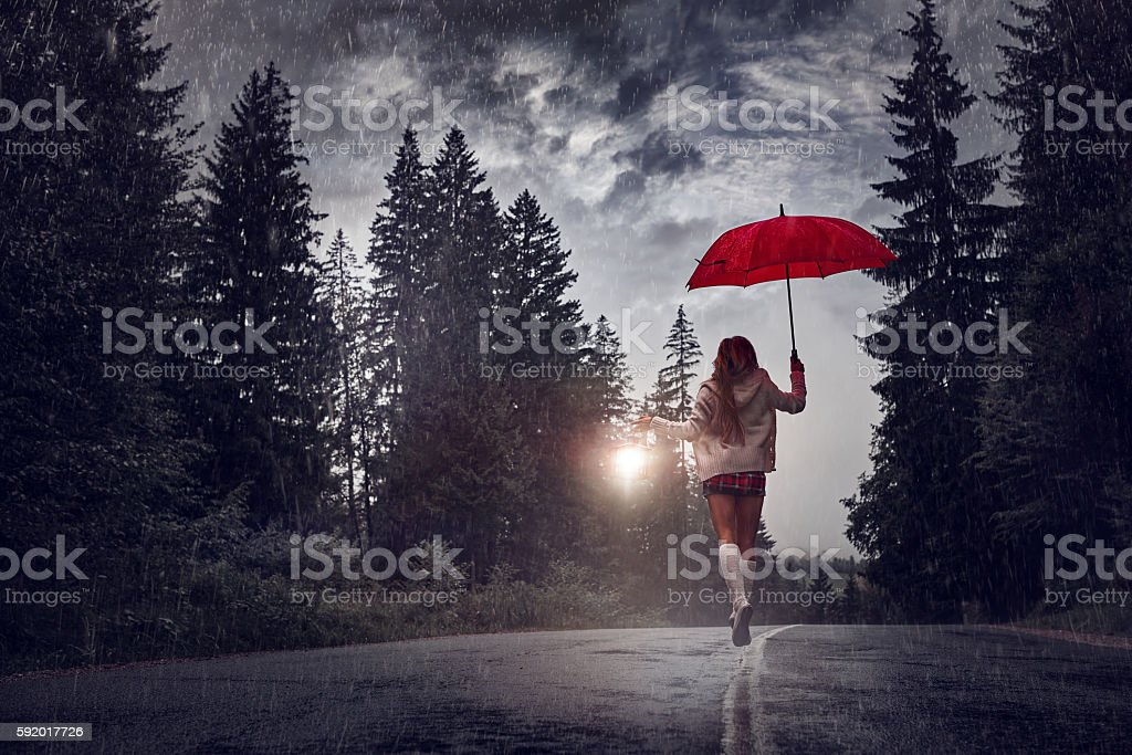 running from the rain stock photo