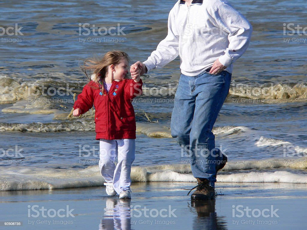 Running from the waves royalty-free stock photo