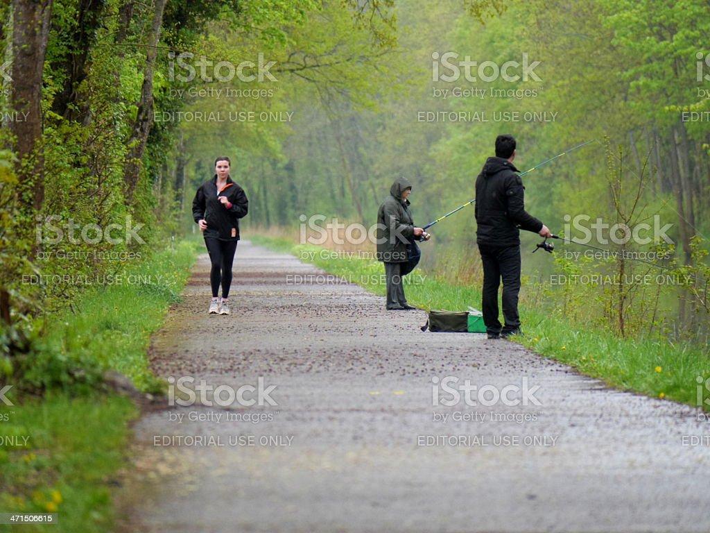 running girl and fishermen stock photo