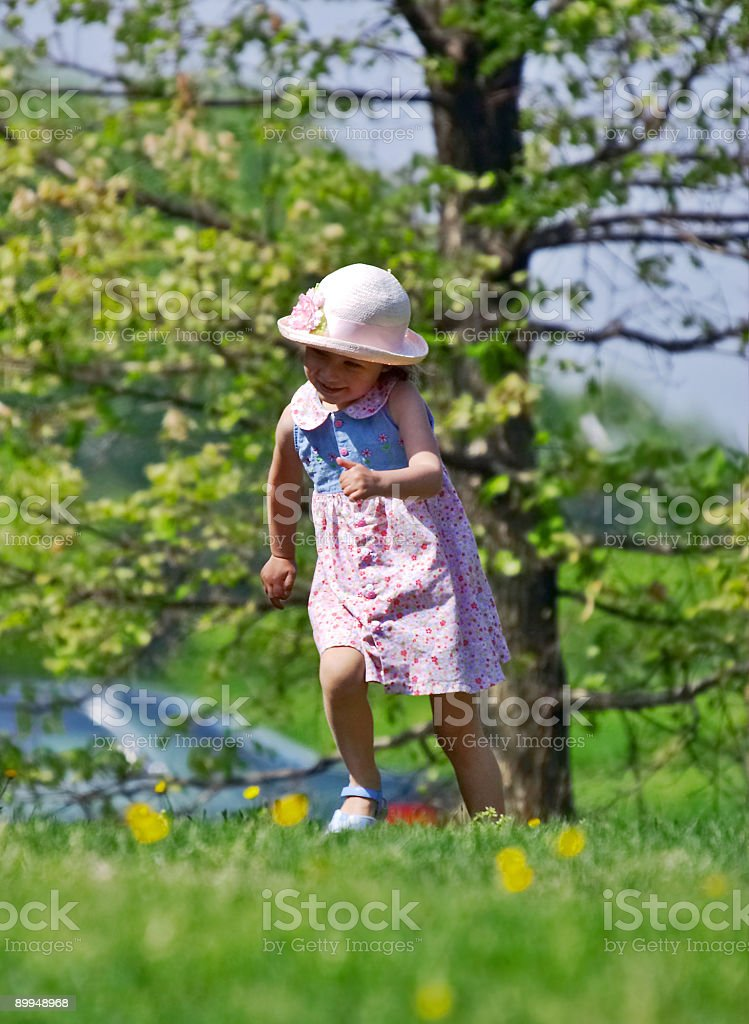 Running girl in a park royalty-free stock photo
