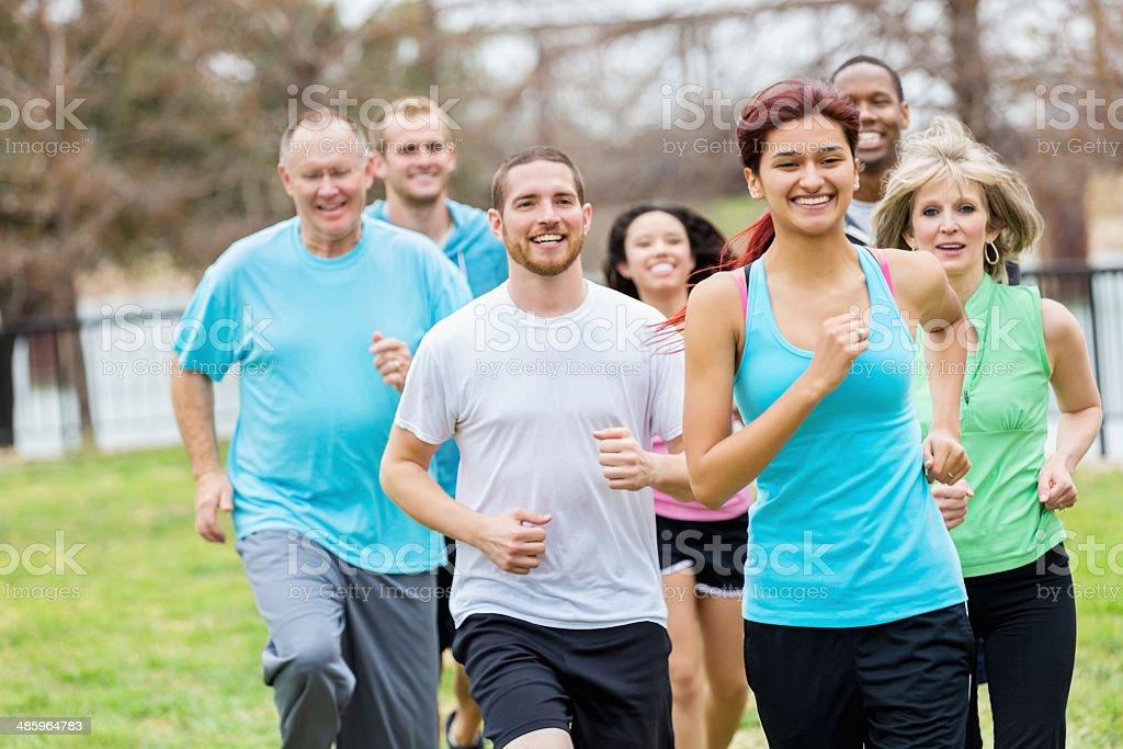 Running group enjoying their run stock photo
