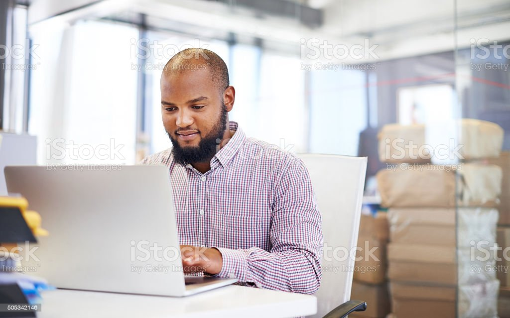 Running his business on a wireless network stock photo