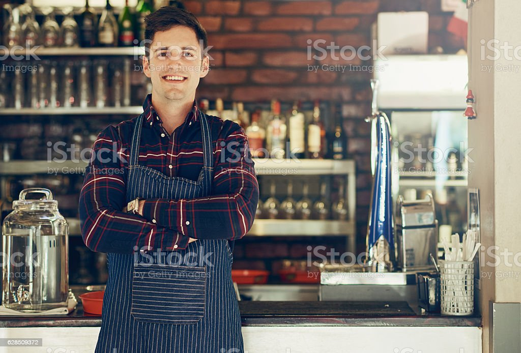 Running his restaurant like a boss! stock photo