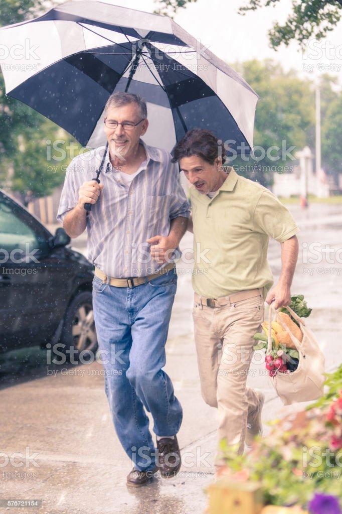 Running Home in The Rain stock photo