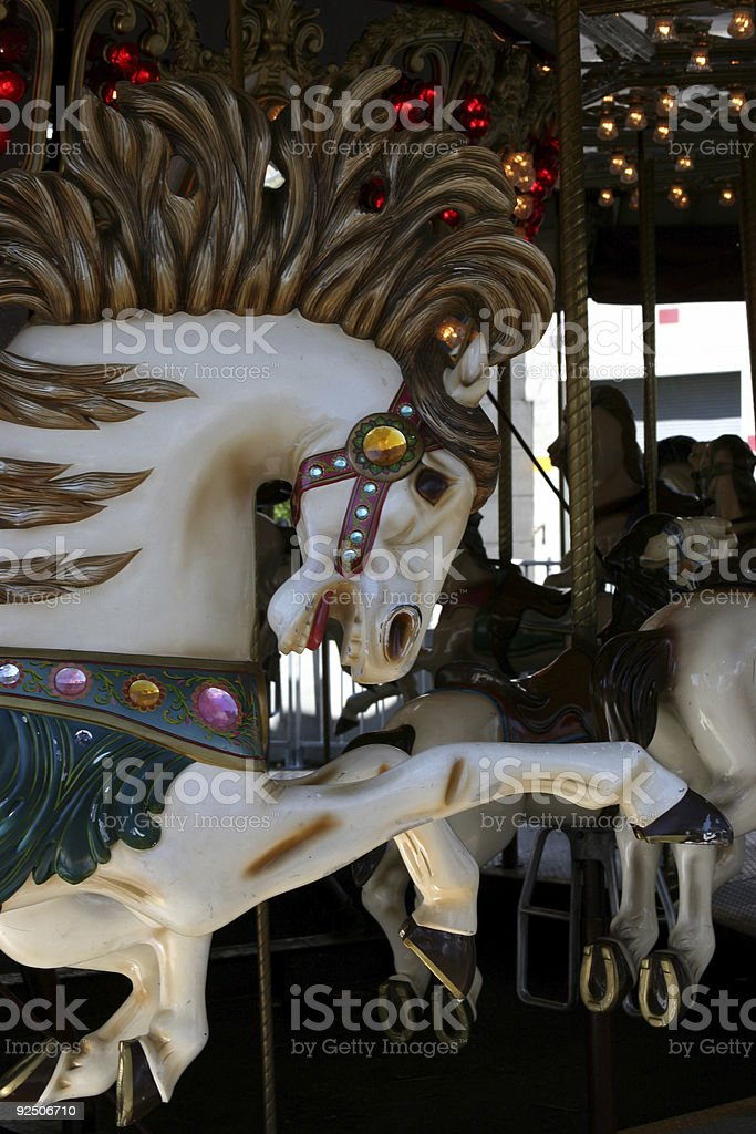 Running horse on a caroussel stock photo