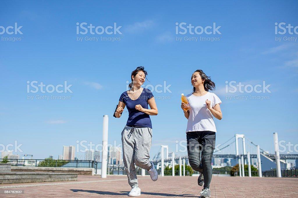 Running in the morning at Daiba stock photo