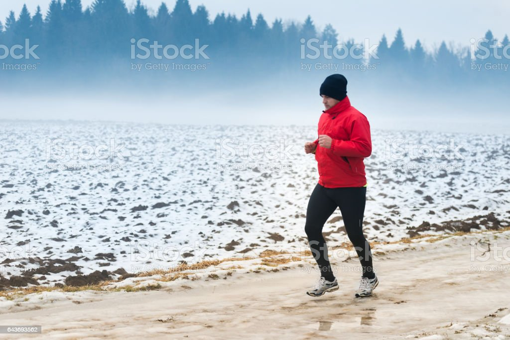Running in winter stock photo