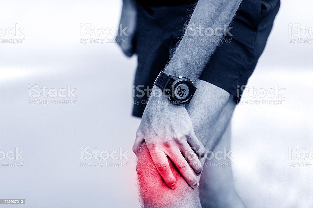 Running injury, knee pain stock photo