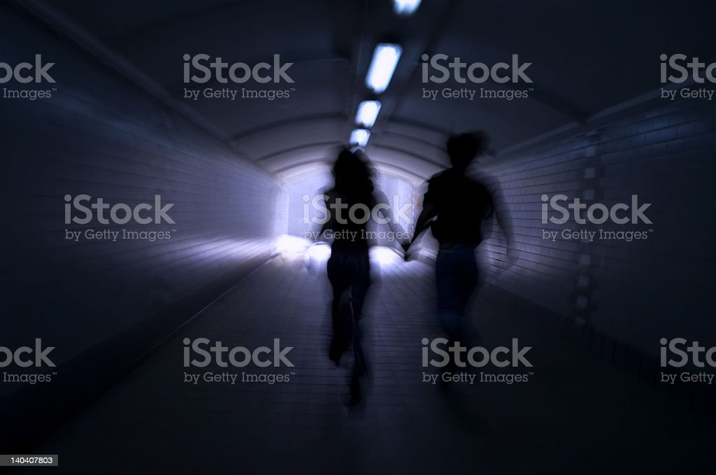 Running into the light stock photo