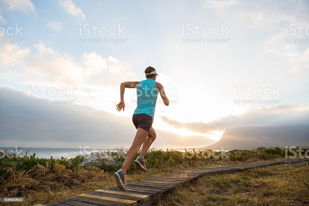 Running into the sunset stock photo