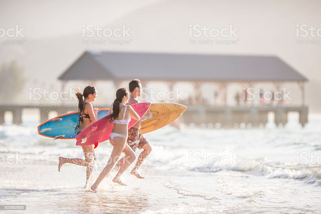 Running into the Surf stock photo