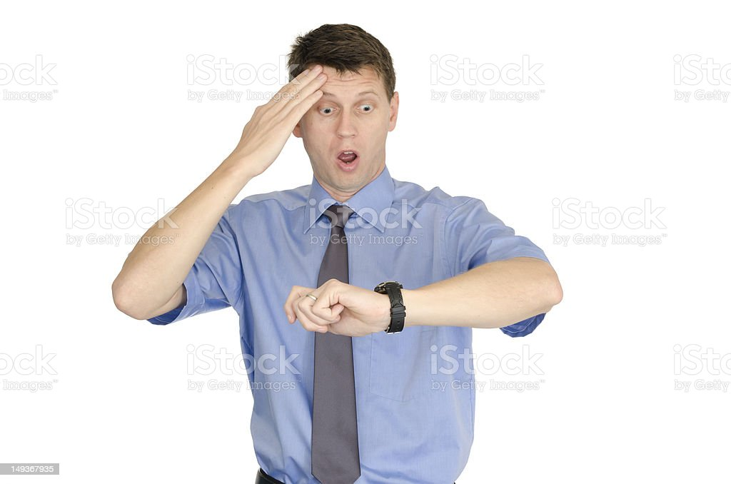 Running late businessman looking at his watch in distress royalty-free stock photo