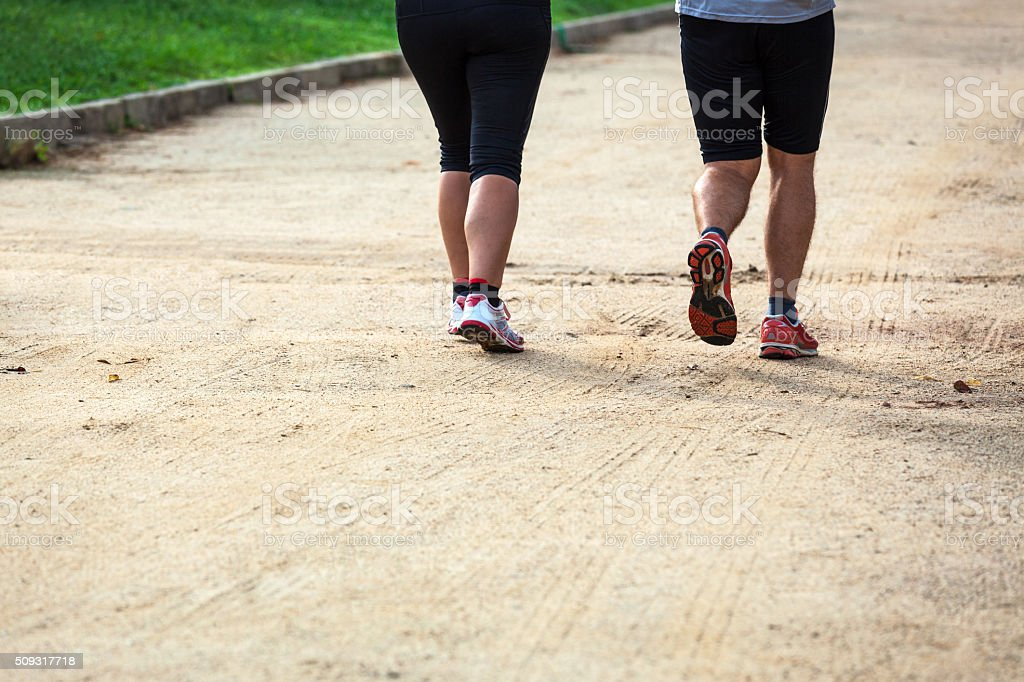 running man and a woman stock photo