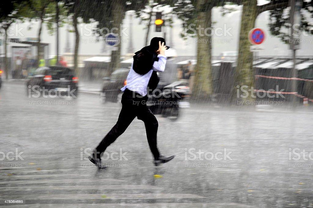 Running man in the rain stock photo