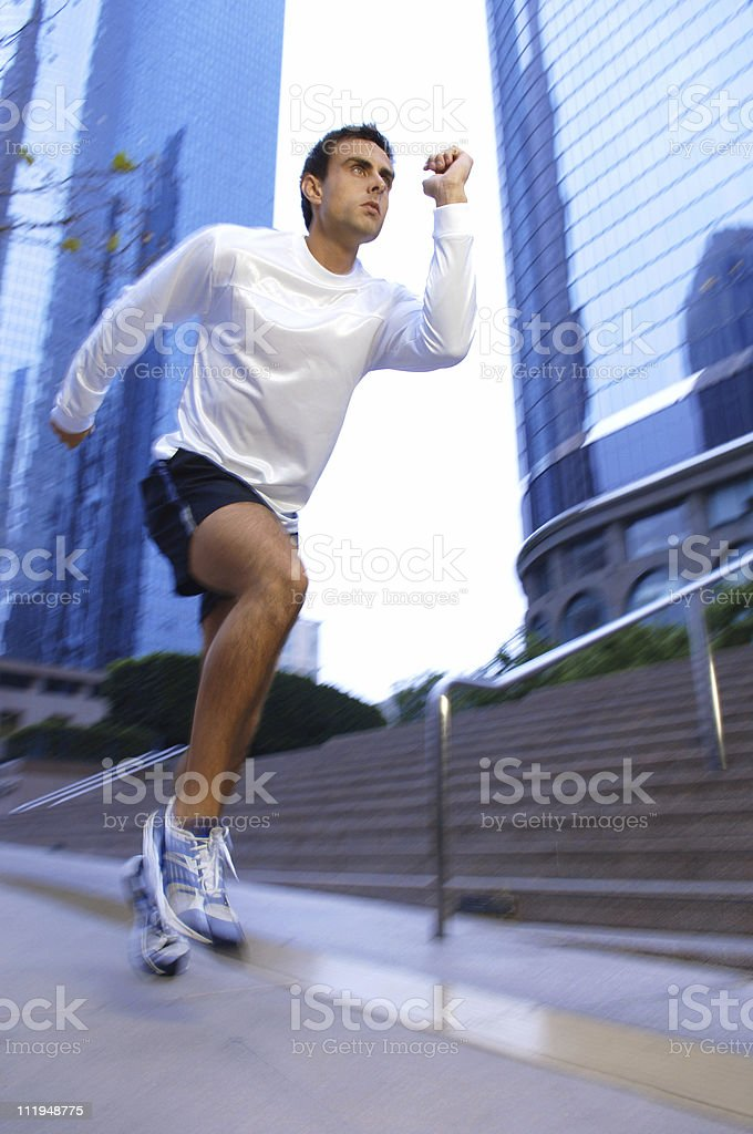 Running Man on Downtown Financial District Street by Mirrored Skycrapers royalty-free stock photo