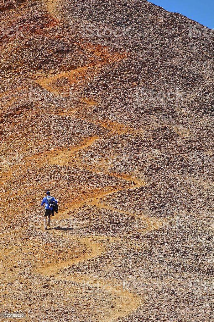 running man uphill stock photo