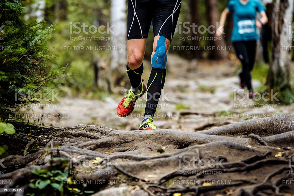 running marathon runner in forest stock photo