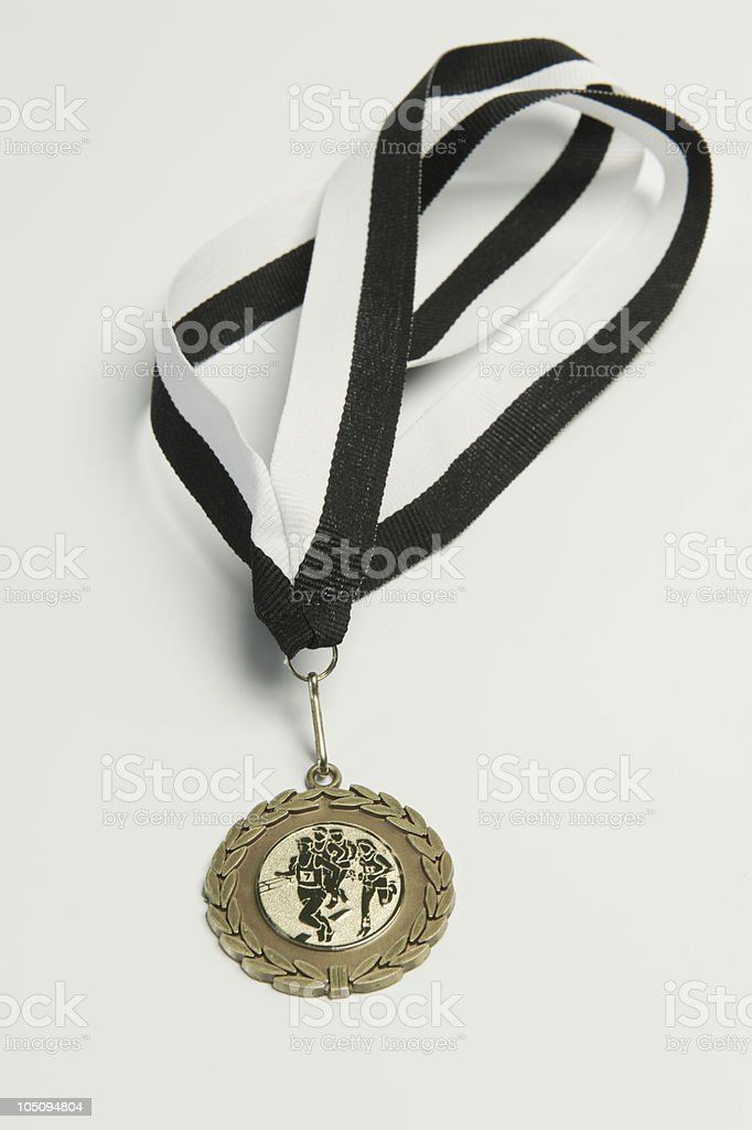 Running medal with black and white ribbon stock photo