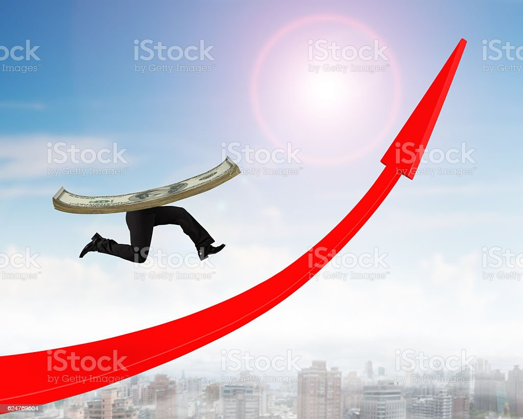Running money with human legs on red arrow up graph stock photo
