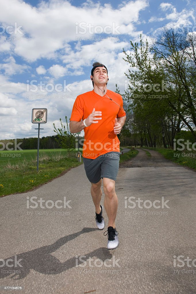 running on a foothpath stock photo