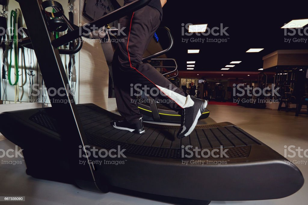 Running on a treadmill in the gym. stock photo