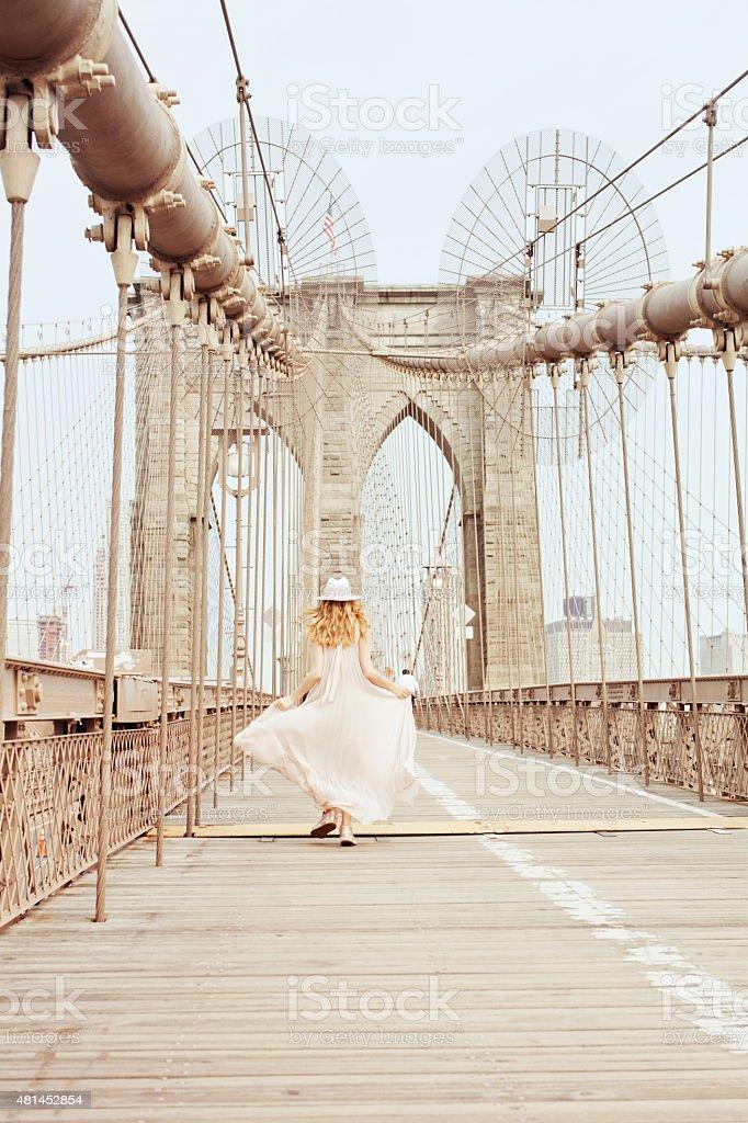 Running on Brooklyn Bridge stock photo